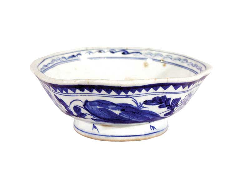 A blue and white bowl with floral ornamentation