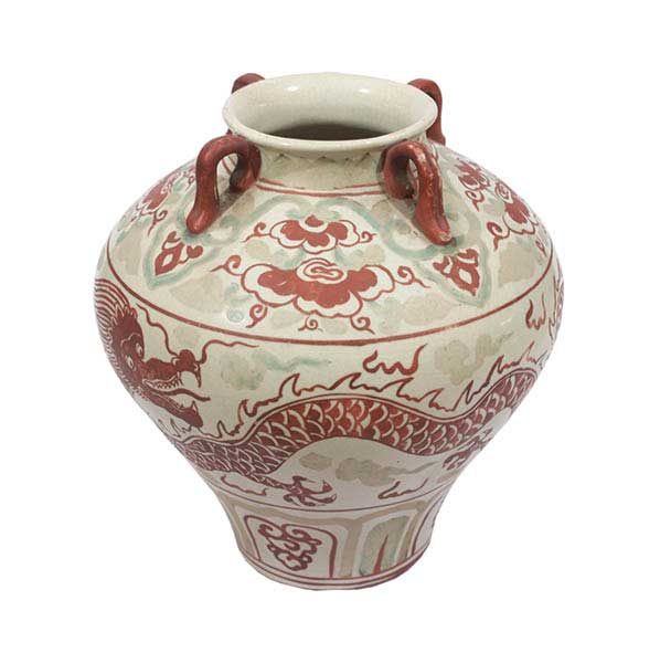 A jar with red dragon decoration