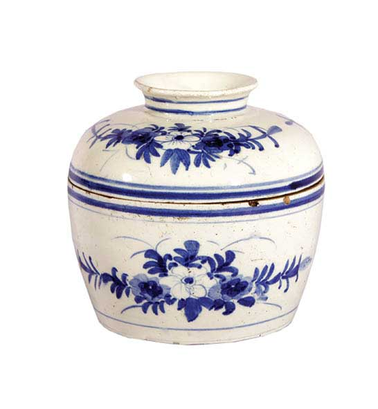 A blue and white jar with lid