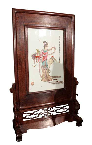 A fine decorated with painted porcelain with wooden frame and stand