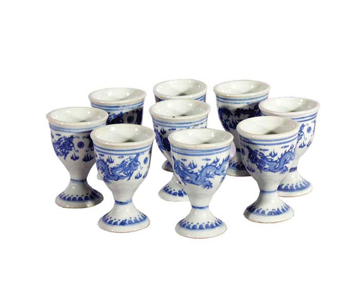 A set of ten blue and white arrack glasses with dragon decoration