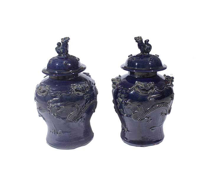 A pair of dark blue glazed covered jars