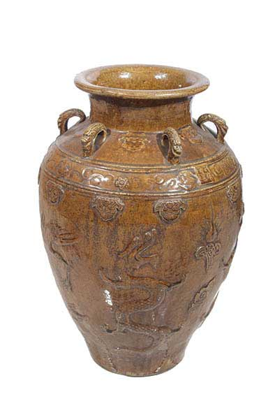 A Qing molded brown glazed storage jar