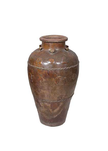 A brown glazed storage jar