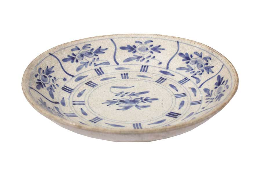 A blue and white dish with flower decoration
