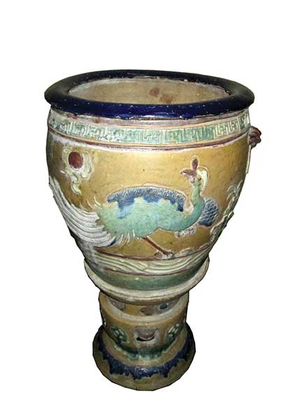 A Chinese stoneware pot and stand with motif colour decoration