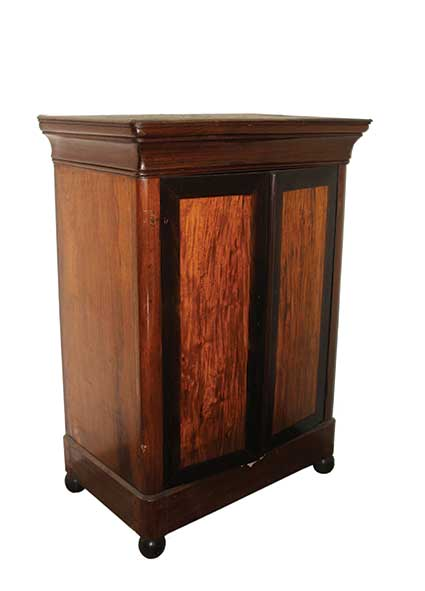 A wooden cabinet with two panelled doors